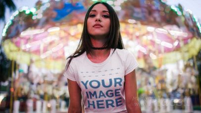 Beautiful Girl Wearing a Tshirt Cinemagraph with a Carousel Behind a13516
