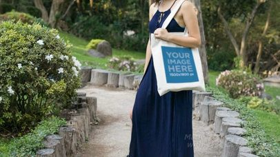 Pretty Girl Holding a Tote Bag at a Garden Path Video a13879
