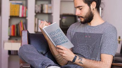 Young Hipster Dude Reading a Book in Stop Motion While on His Armchair Falling Asleep a13828