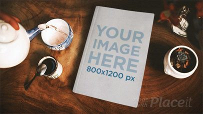 Book Lying on a Wooden Table While Serving Tea in Stop Motion a13827