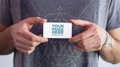 Stop Motion of a Guy Holding a Business Card That Magically Disappears a13784