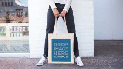 Girl Changing her Pose While Holding a Tote Bag in Stop Motion a13641
