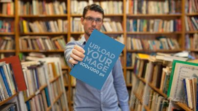 Stop Motion of a Young Man at a Library Holding a Book on His Hand Showing It a13853