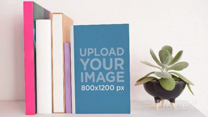 Book on a Shelf Against Other Books with a Plant Rotating Nearby in Stop Motion a13865