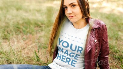 Young Woman Lying in a Field Wearing a T-Shirt Stop Motion a13312