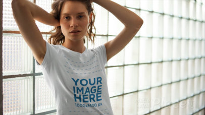 Blonde Young Girl Posing Against a Window Wearing a T-Shirt in Stop Motion a13541
