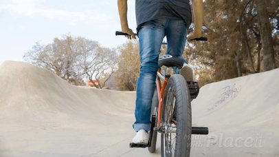 Dude Riding a BMX Bike While Wearing a Snapback Hat Backward in a Skatepark Video Mockup a14191