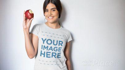 Video of a Beautiful Girl Eating an Apple Wearing a T-Shirt a13230