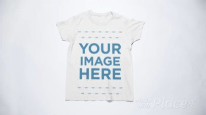 Round Neck T-Shirt Stop Motion Folding into a Ball on a White Surface a13150