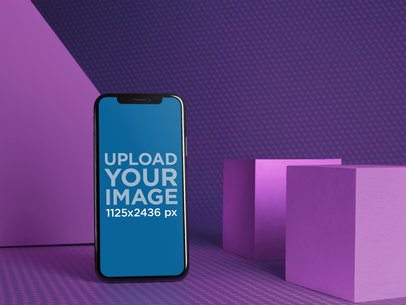 Black iPhone X Mockup in a Textured Room with Shapes a19713