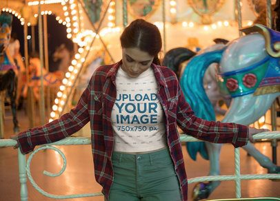 Bored Girl Wearing a Crop Top Tee Mockup Against a Carousel a19448