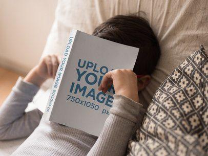 Book Mockup Lying Over a Sleeping Boy's Head a19154