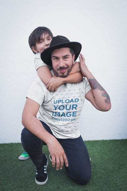 Tattooed Dad with his Kid Wearing a T-Shirt Mockup a20294