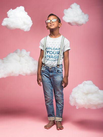 Mockup of a Black Boy Wearing a T-Shirt in a Pink Room with Clouds a19910