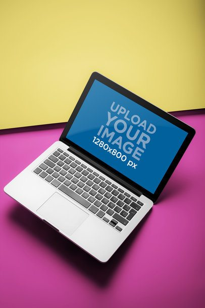 Mockup of an Angled MacBook Pro on a Two Color Surface a20463