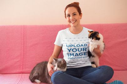 Happy Cat Lady Wearing a T-Shirt Mockup Sitting on her Sofa a18981