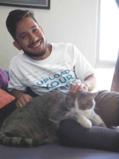 Smiling Hispanic Man Wearing a T-Shirt Mockup with his Cat a18991