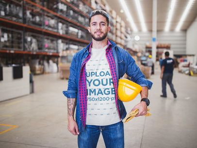 Happy Worker Wearing a T-Shirt Mockup at the Warehouse a20389