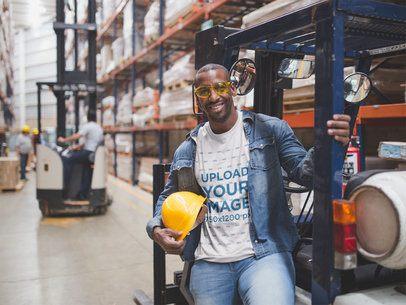 T-Shirt Mockup Featuring a Black Man Wearing Construction Gear at a Warehouse a20447