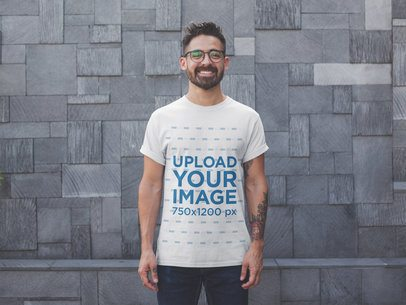 Front Shot T-Shirt Mockup Featuring a Happy Man with Glasses 20745