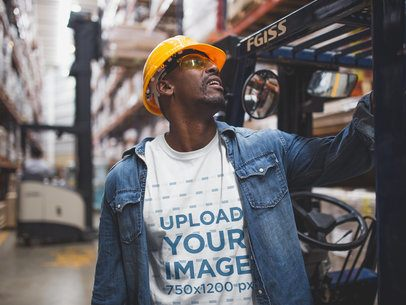 Industrial Worker Checking Out a Forklift Wearing a T-Shirt Mockup a20385