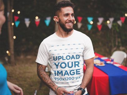 Smiling Man Wearing a Tshirt Mockup at a 4th of July BBQ a20840