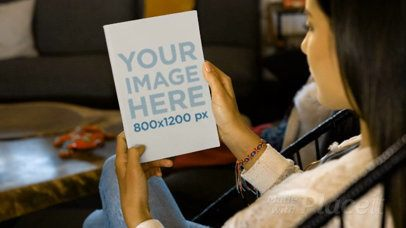 Video Of A Girl Holding A Flyer On Her Hands While Sitting On An Acapulco Chair Mockup 14009a