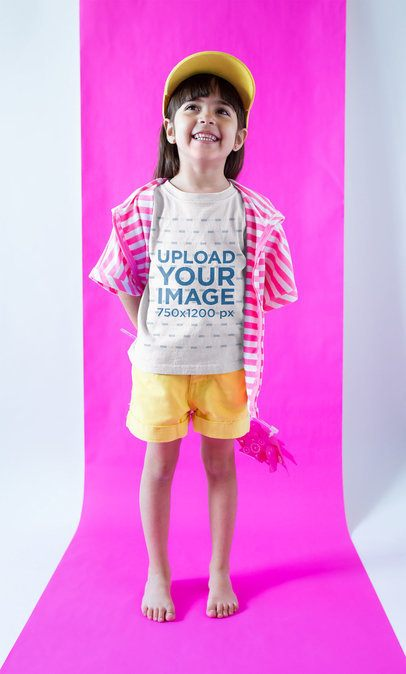 Smiling Girl Wearing a Tshirt Mockup in a  Fuchsia and White Room a19468