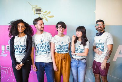 Interracial Group of Five Coworkers Wearing T-Shirts Mockup at a Startup a20413