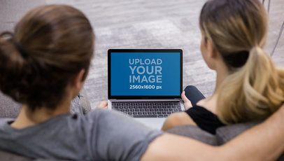 Overshoulder Shot of a Couple Using a MacBook Mockup a20994
