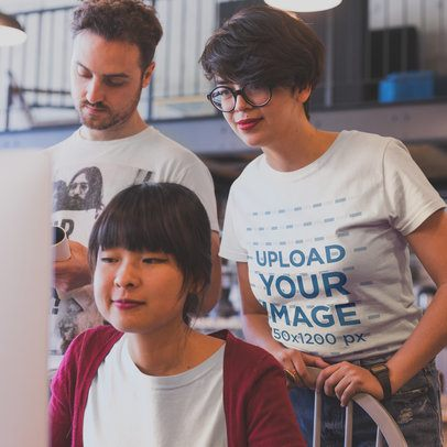 Girl Wearing a Tshirt Mockup while Coaching a Coworker at a Startup a20420