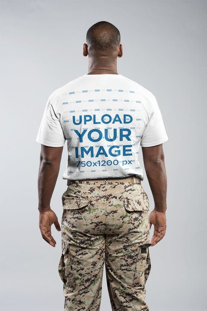 Back of a Veteran Soldier Wearing a T-Shirt Mockup in a White Room a20932