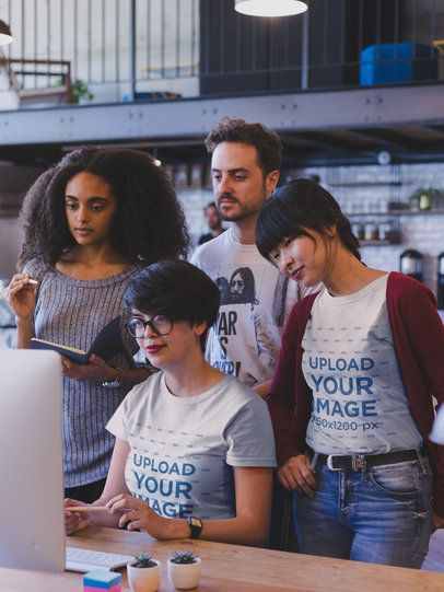 Group of Coworkers at a Startup Wearing T-Shirts Mockup While at a Meeting a20419