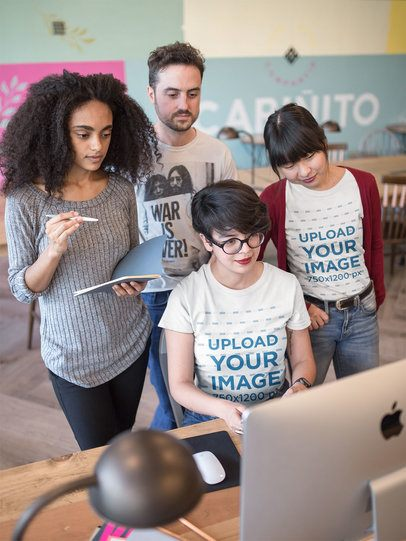 Women Wearing Round Neck Tees Mockup at a Workstation with Coworkers a20433