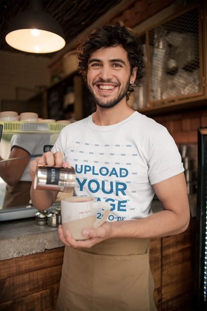 Mockup of a Smiling Waiter Wearing a T-Shirt while Preparing a Mocha a20473