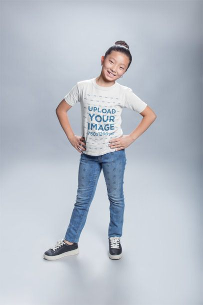T-Shirt Mockup of a Happy Girl Posing in a Studio 20945a