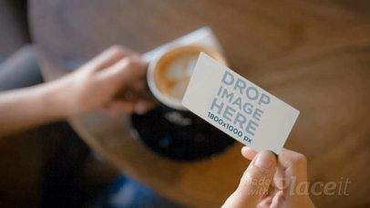 Video of a Business Card Being Held by a Person while Having a Coffee a13943