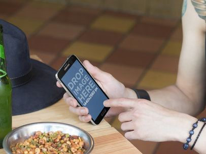 Android Mockup of Rocker Guy Checking His Phone