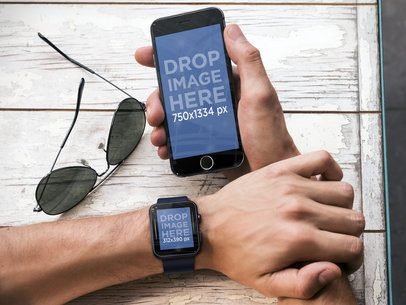 Top Shot Mockup of Man Holding iPhone 6 and Wearing a Black Apple Watch