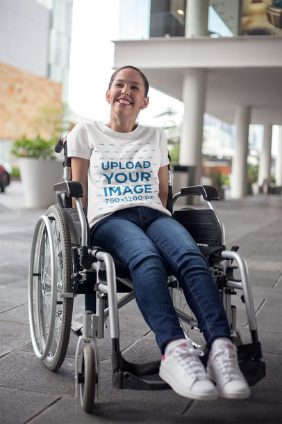 Mockup of a Happy Girl Wearing a T-Shirt Sitting on a Wheelchair 21361a