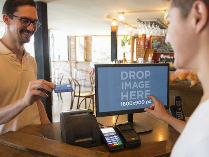 Man Making a Payment at a Restaurant Desktop PC Mockup