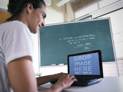 Mockup Template of Male Student in Classroom Using an HP Laptop
