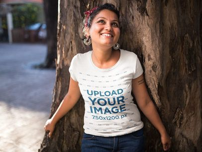 Mockup of a Happy Girl Wearing a Tshirt Against a Tree 20571