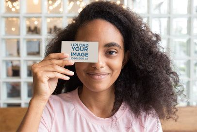 Mockup of a Girl Holding a Business Card Against her Face 21922