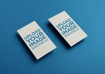 Two Vertical witBusiness Cards Mockup Floating Over a Solid Surface 21949
