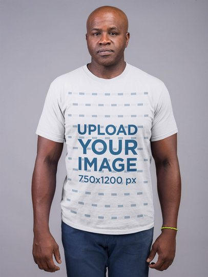 Mockup of a Serious Man Wearing a T-Shirt and Jeans 21476