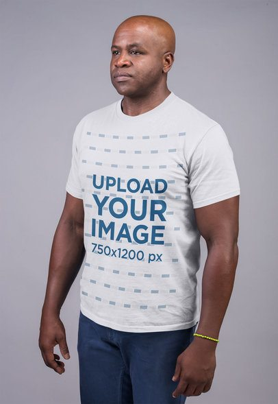 Mockup Featuring a Serious-Looking Man Wearing a T Shirt Against a Flat Background 21477