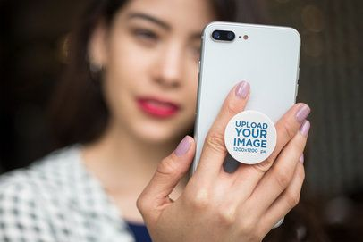 Phone Grip Mockup Held by a Woman Staring at Her Screen 22144