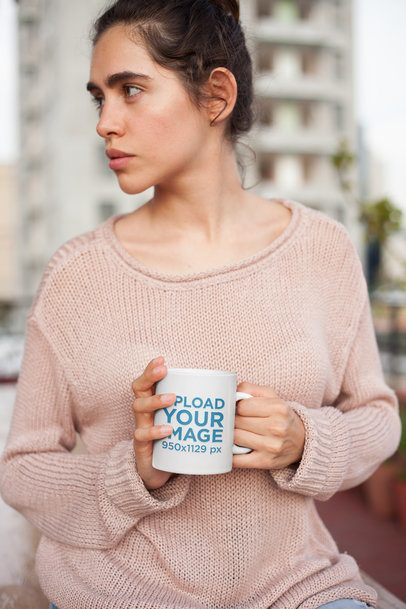Mockup of a Woman Holding a Coffee Cup Wearing a Knit Sweater 22437