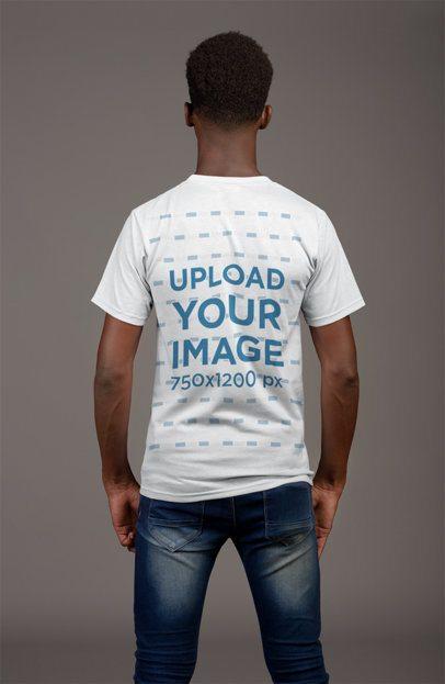 Back View T-Shirt Mockup of a Thin Man Against a Flat Gray Wall 21158